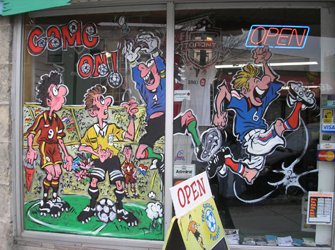 Promotional window art work for soccer store.