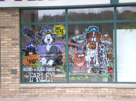 "Promotional window art for ""The Farley Fund"" at the Guelph Animal Hospital."