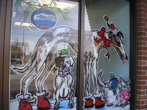 Christmas window art for pet shop.