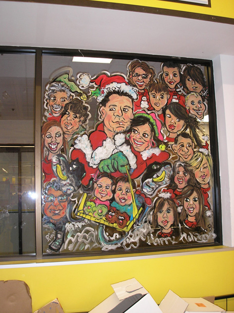 Christmas caricatures of No Frills staff.