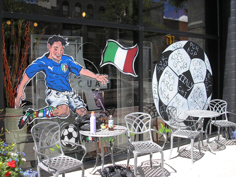 World Soccer promotional window art for local business.
