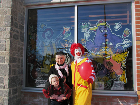 Dorothy with Ronald MacDonald in front of her window art!