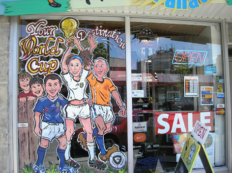 Window art work for local sports store featuring the upcoming World Cup Soccor.