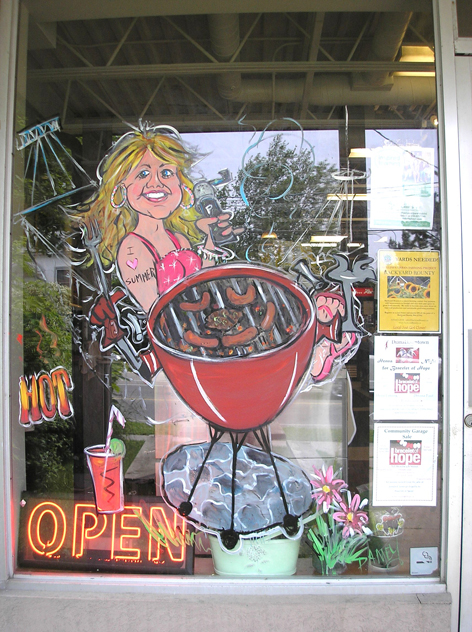 Promotional window art work for local store.