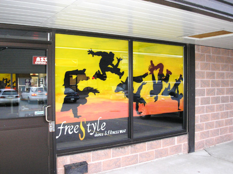 Promotional window artwork for Free Style dance and fitness wear.