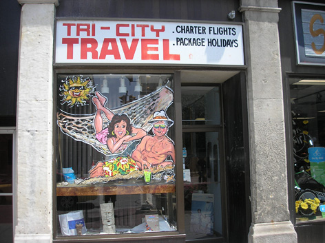 Promotional window art work for Tri-City Travel.