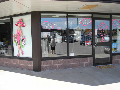 Promotional window art work for Smitten clothing store.