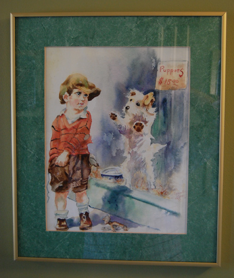 Water colour of a boy and puppy for sale in the window.