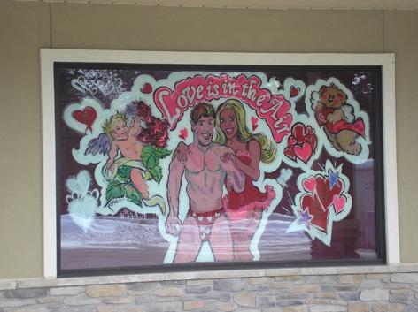 Valentines window art work for love shop.