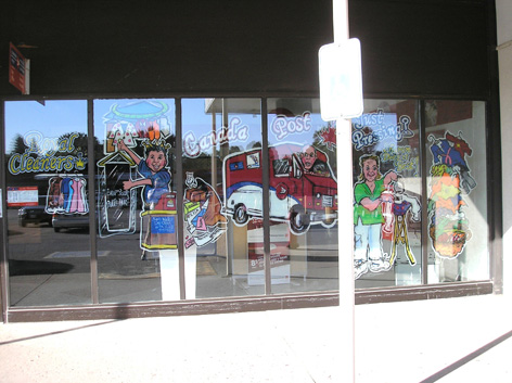 Promotional window art work for local dry cleaning company with a Canada Post outlet attached.