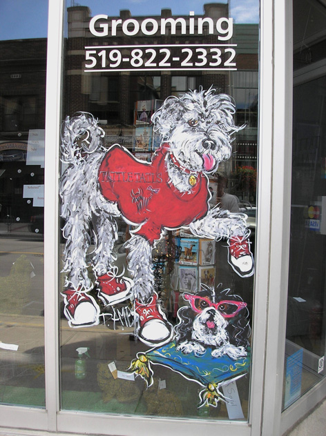 Promotional window art work for pet store.
