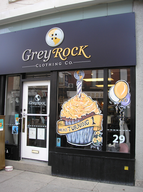 Promotional window art for Grey Rock Clothing Co.