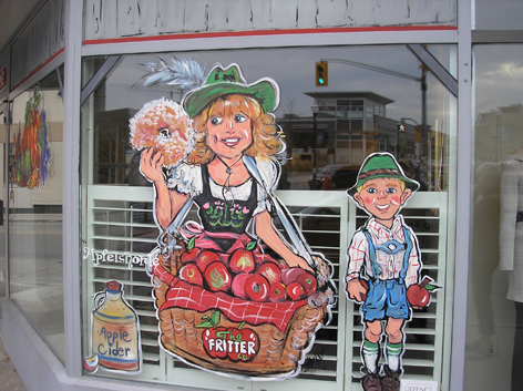 Promotional window art work featuring Oktoberfest for local business in Kitchener/Waterloo.