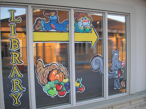 Seasonal window art work for local library.