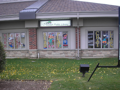 Seasonal window art for local library.
