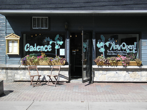 Promotional window art work for Cadence vegan restaurant.