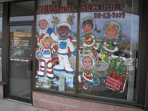 Christmas astronaut themed window artwork for local dentist office.