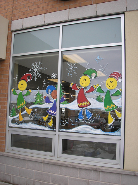 Seasonal window art work for Guelph Library.