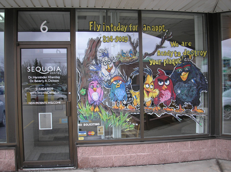 Promotional window art work for local dentist office.