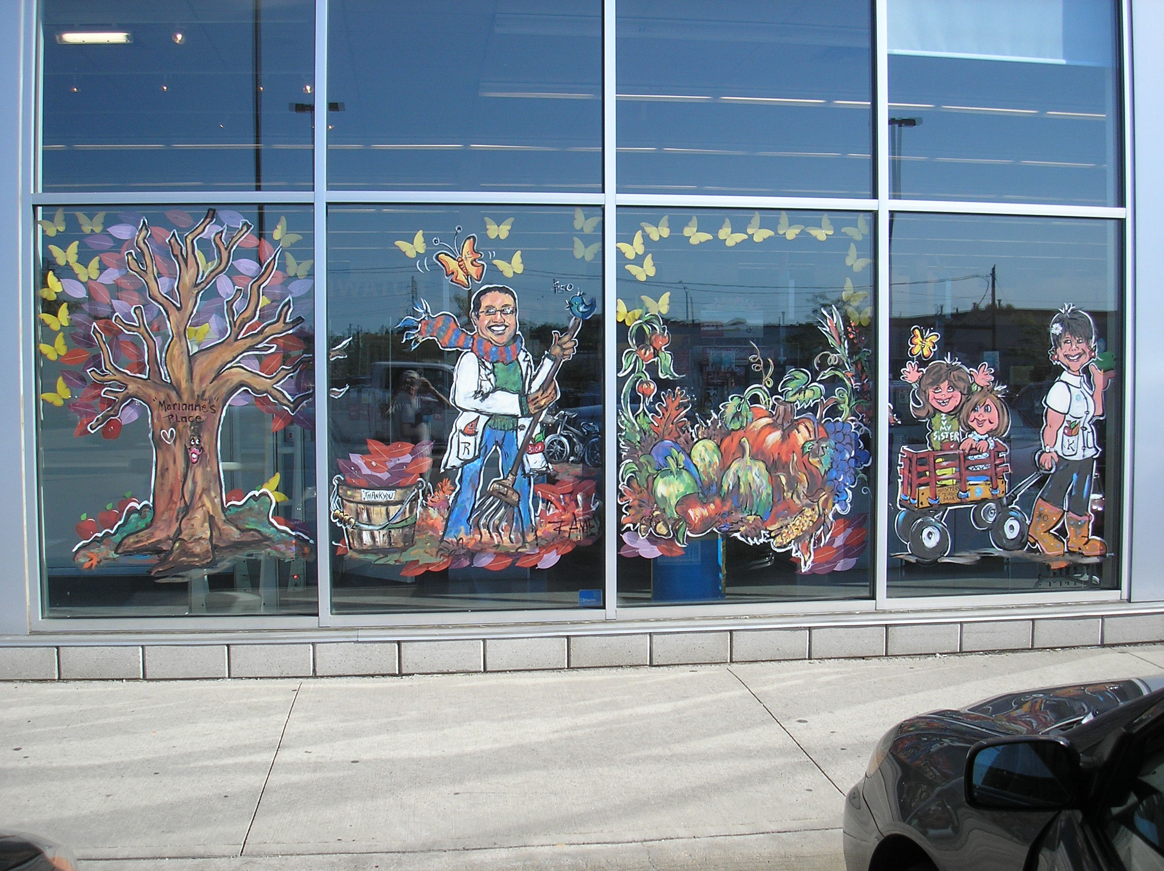Window art work on Shopper's Drug Mart promoting a Fund raiser for Marianne's Place, (women shelter) in Guelph.