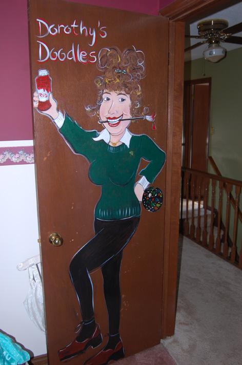 Caricature of Dorothy on door from past art studio.