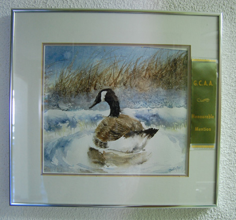 Water colour of a Canadian goose on a pond.