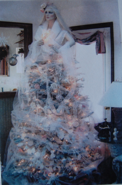 Christmas tree decorated as Snow Queen.