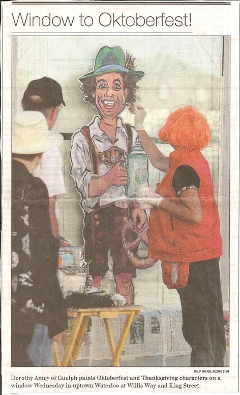 Dorothy Amey painting a window for Oktoberfest in Waterloo.