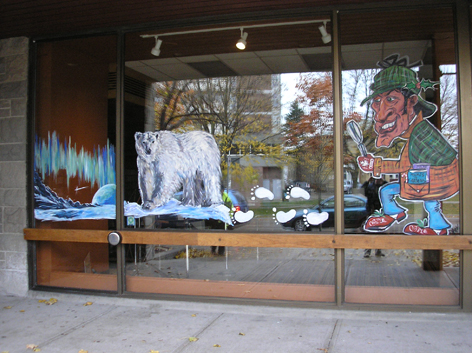 Promotional window artwork altered for the winter holiday season for The Guelph Public Library.
