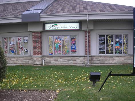 Seasonal window art for local library.